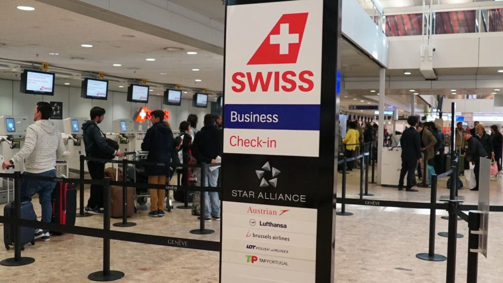 swiss check in español